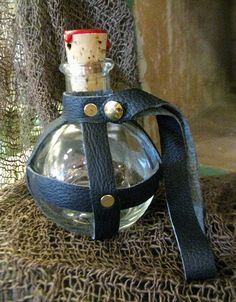 Pirate/Steampunk Glass Round Bottle, Flask,  Navy Blue Leather-Wrapped. $18.00, via Etsy.