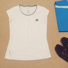 Adidas adipure workout top Condition is very good. Gently used condition. No stains, rips or piling. Fabric is the sweat wicking type that lets the skin breathe. No integrated bra. Adidas Tops Tees - Short Sleeve