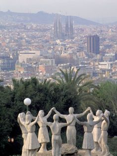Sardana - Sculpture with Barcelona in Background by David Marshall