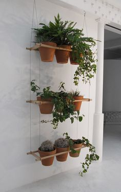 A clever use of space, this pot hanging system can be simply made using dowel and marine grade steel cables. Or you could repurpose an sturdy old wooden clothes airer for the same purpose