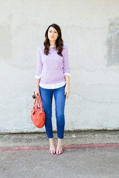 Lavender sweater with white button-up and red patterned shoes.