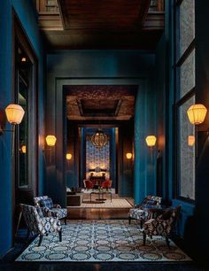 COLOUR - Beautiful blue walls, high ceilings and lantern sconces • #momufurniture •