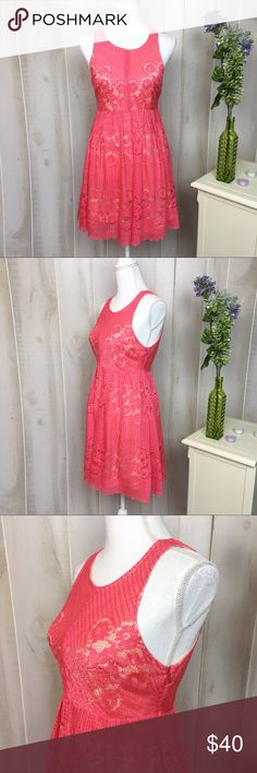 Free People Open Back Pink Lace Dress With a flared skirt, this lace dress is ideal to wear out on the town. Made from polyester, this dress is a lovely piece. In good condition. Approximate measurments lying flat: 16.5' bust, 13.5' waist, 34' length 30479 Free People Dresses Mini