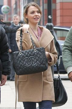 Expensive: Kate Ford finished off her otherwise casual look with a pricey Chanel bag on Th...
