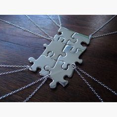 Six set jigsaw necklace.