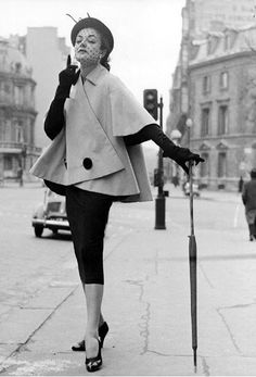 1950 Model wearing dress and coat by Jacques Fath,
