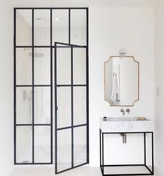 The subtle pattern on the glass doors is very chic. #crittall #bathroom