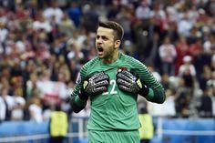 TOPSHOT - Poland's goalkeeper Lukasz Fabianski reacts during the Euro 2016 group C football match between Germany and Poland at the Stade de France stadium in Saint-Denis near Paris on June 16, 2016. / AFP / MIGUEL MEDINA