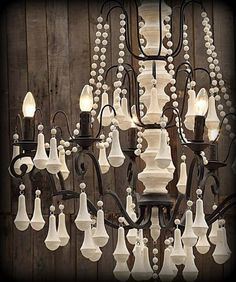 "Love this wooden chandelier.  Picture from ""Fluff Your Stuff Interiors""."