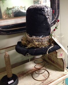 Adorable primitive grungy festive snowman stovepipe hat on rusty bed spring by MyPrimitiveBlessings on Etsy. https://www.etsy.com/listing/208788105/adorable-primitive-grungy-festive?