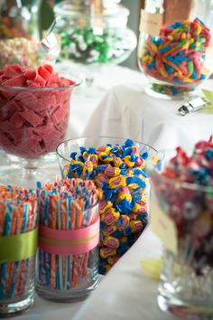 Candy Bar at your reception. Tie jars with big black bows and a little glitz in the middle.