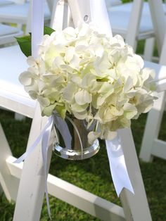 Cute hydrangea buckets (don't know if it would match with the flower balls though...) reused at the bar?