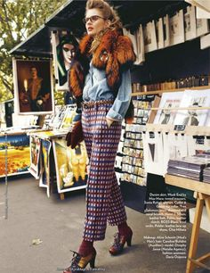 "Dimphy Janse with art, books, and magazines at the Bouquinistes of Paris in ""From Paris with Love"" for Marie Claire India, November 2011. Photographer: Dennison Bertram. ""Denim shirt, Week End by Max Mara; tweed trousers, Sonia Rykiel; glasses, Cutter & Gross; fur collar, Yves Soloman, onyx, diamond and coral brooch, Henri J Sillam; leather belt, Pablo; leather clutch, BOSS Black; wool socks, Polder; leather lace-up shoes, Chie Mahara."""