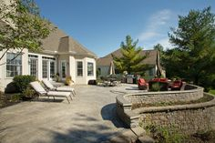 Concrete patio with stone retaining walls