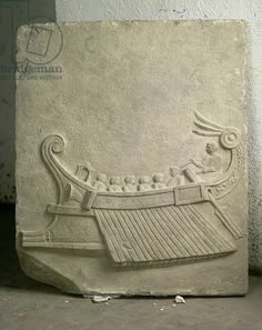 Carved tablet depicting a trireme (stone). Roman, (1st century BC) / Museo Archeologico Nazionale, Naples, Italy / The Bridgeman Art Library.