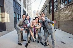 Can't get over these groomsmen suits! This palette turned out amazing with pewter, plum and seafoam green! Grace Floral Design, www.evetheflorist.com, Photo credit to: Sandra Ellen Photography