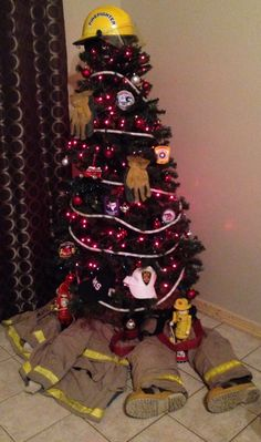 Firefighter Christmas Tree?  Decorated with patches and accessories!  Cute.