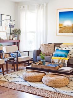 HGTV shows you how to get that high-ceiling effect with low to the ground furnishings.