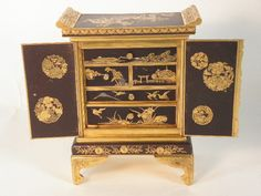 Japanese Komai Style Miniature Inlaid Mixed Metal Cabinet 19 20th C MINIATURE CABINET, THE FITTED INTERIOR WITH FIVE DRAWERS FINELY CHASED AND INLAID DECORATION , SIGNED ON THE BASE IN A FAN RESERVE AND WITH FLORAL AND BUTTERFLY ROUNDELS HEIGHT 14.6 CM DEPTH 6.2 CM WIDTH 10.5 CM