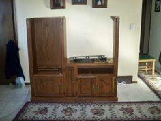 Turn an entertainment center into a HDTV stand; be cool to make wider and leave storage on the side.