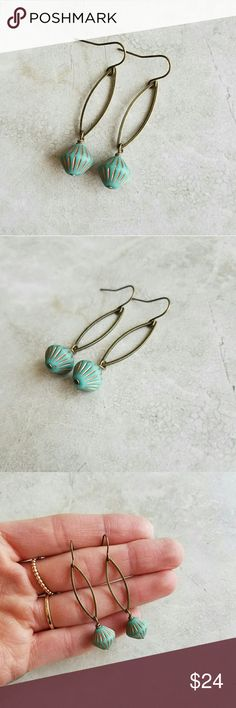 """Turquoise Drop Earrings Lovely, simple yet unique earrings. Antiqued brass marquise charms with turquoise & copper detailed glass beads.  Earrings measure 2"""" long.   **Handmade in California. Anthro used for exposure. Anthropologie Jewelry Earrings"""