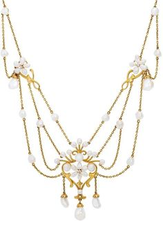 An Art Nouveau Freshwater Pearl, Diamond and Gold Swag Necklace, circa 1900. Via Past Era Antique Jewelry http://www.pastera.com/art-nouveau-freshwater-pearl-swag-necklace-with-diamonds#.VhAK8NaaKJU(693×960)