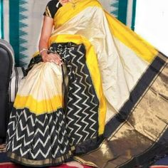 White Ikkat saree with zig zag pattern in yellow with black border. Comes with an attached blouse. Indian Attire, Indian Wear, Indian Outfits, Indian Style, Indian Dresses, Ikkat Pattu Sarees, Pochampally Sarees, Bandhani Saree, Pure Silk Sarees