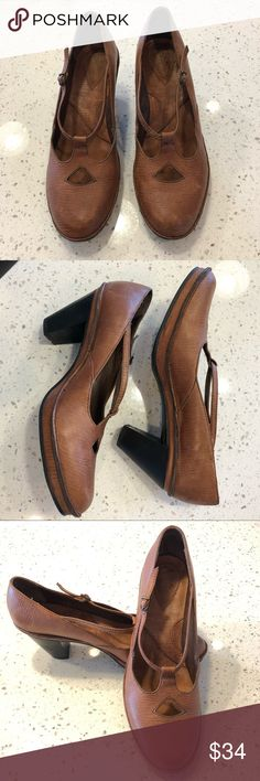 """Clarks Artisan Cut-Out Mary Jane Shoes Caramel tan leather Mary Jane style shoes with cutouts and buckle fasteners. Slightly rugged looking. Gently worn, in excellent condition. Heel height 3"""" on a 1/2"""" platform. Clarks Shoes Heels"""
