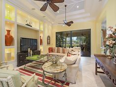 Yellow Family Room with warm accents- Grey Oaks - Melinda Gunther Naples Realtor