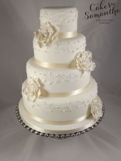 Alice - 4 tier Wedding cake with ruffle roses with delicate trailing piping with blossom and bird detail.