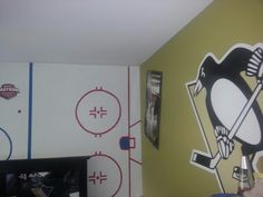 I like the wall on left! Hockey theme room except sooooo NOT Penguins. Pittsburgh Penguins Wallpaper, Pittsburgh Penguins Logo, Pittsburgh Steelers, Penguin Drawing, Penguin Art, Modern Man Cave, Hockey Bedroom, Hockey Decor, Man Cave Home Bar