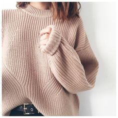 Tuck in a chunky beige-toast sweater into your belted denim for the weekend.