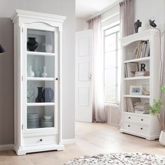 Add depth and character to any room with this gorgeous white mahogany glass cabinet.