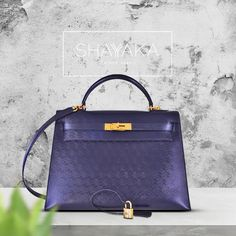 Ultra Rare Hermès Kelly in Indigo Monogram Sellier Leather and Gold Hardware | Size 32cm | Discontinued and no longer available to order | Available Now  For purchase inquiries, please contact sales@shayyaka.com or +961 71 594 777 (SMS, WhatsApp, or iMessage) or Direct Message on Instagram (@Shayyaka)  Guaranteed 100% Authentic | Worldwide Shipping | Bank Transfer or Credit Card