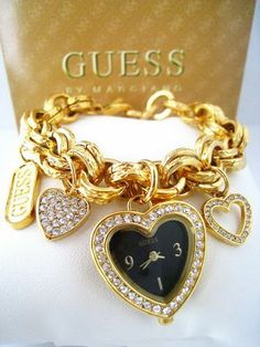 What color and style watch do you think would look the best with this charm bracelet watch?   http://watchesinthemovies.com