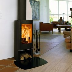Kernow Fires Scan 45 mini on a circular steel hearth wood burning stove installation in Cornwall. Stove Installation, Home Renovation, Wood Burning, Hearth, Stove, Wood, Summer House, Seasoned Wood, Contemporary Decor