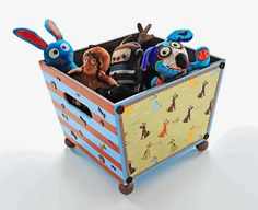 Pet toy storage with decoupage, wood crate, wood balls, paint, and scrapbook paper