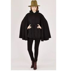 """Samantha Pleet Bona Drag Minimalist wool cape coat SOLD OUT everywhere! From website:Sleek cape-style hooded coat, from the New York designer Samantha Pleet, crafted form a durable poly blend. Features a button-down front placket, a tie-waist, side pockets, and comes complete with a removable cape back.   Content + Care  - Polyester, nylon, acrylic  - Dry clean  - Imported   Size X- Small! Fits true to size. I'd recommend for a 33"""" chest and smaller.             Lovers of: Totokaelo / Ovate…"""