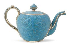 RUSSIAN SILVER-GILT & CLOISONNE ENAMELED TEA POT Ivan Saltykov. The body extensively enameled in turquoise enamel, the borders with white enamel beading and the interior brightly gilded. Hallmarked Moscow, dated 1894, Cyrillic maker's mark I.S. and 84 standard. Height 4.75 inches (11.5 cm), width 7.5 inches (19 cm).