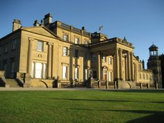Broughton Hall, a Georgian country house, has been the seat of the Tempest Baronets for 900 years. A 14th-century document records the acquisition of a house & part of the manor of Broughton. The pedimented end wings were added to the main structure 1809–11, Sir Charles Tempest, Bt. (1794–1865) refaced the north front in golden Kendal stone & added a portico, 1838–41. The park was landscaped in the 18th & 19th centuries & the Italianate terraced garden designed  circa 1855.