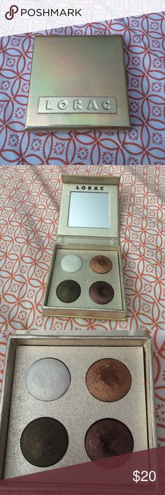 Lorcac TANtalEYES baked eye shadow pallete Used once or twice. Mirror on inside still has plastic on it. There is a white shimmer eyeshadow with gold pearl. This is an excellent, highly-pigmented highlighter that can be used in many ways. Then, there is a golden bronze eyeshadow, an olive green with gold pearl eyeshadow and a shimmering garnet eyeshadow. These can be used wet or dry Lorac Makeup Eyeshadow