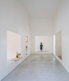Simple grey and white interior inside the House in Amagi by Atelier Cube.