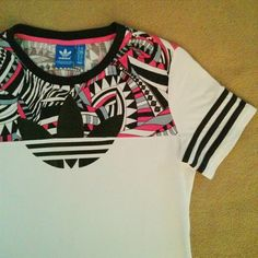 Adidas Abstract Print White T-shirt Soccer/football style white t-shirt w/ black & pink abstract/geometric print by Adidas. Size XS. Great ready to wear condition as pictured. {No trades or Pp} Adidas Tops Tees - Short Sleeve