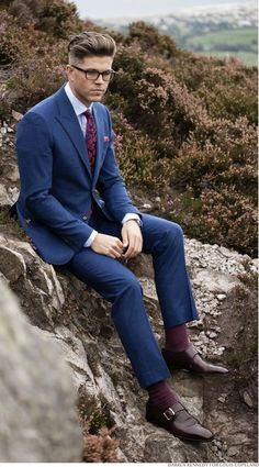 Navy maroon combo inspiration with a blue suit maroon single monk shoes light blue shirt maroon silk patterned tie maroon pocket square maroon socks from Louis Copeland Blue Suit Brown Shoes, Blue Suit Men, Navy Blue Suit, Blue Suits, Blue Suit Blue Shirt, Burgandy Suit, Blue Suit Outfit, Burgundy Tie, Mens Fashion Suits