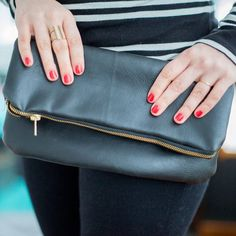 Sew your own leather foldover clutch. Free tutorial on how to add liner fabric!