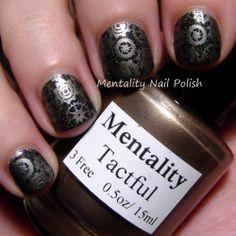 Mentality Nail Polish - Tactful, a blackened gold metallic creme nail polish, dries to a satin finish.