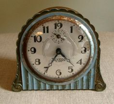 Though weathered with use, this lovely blue metal clock carries enough charm to make up for the fact that it no longer tells time. Its scalloped