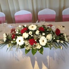 Wedding Flower Arrangements Top table arrangement In roses and gerbera red and white Red Flower Arrangements, Rosen Arrangements, Altar Flowers, Wedding Flower Arrangements, Table Arrangements, Wedding Centerpieces, Wedding Decorations, Bridal Table, Table Wedding