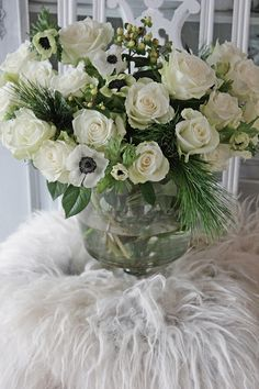 Love white and green arrangements. Anemone, roses, pine