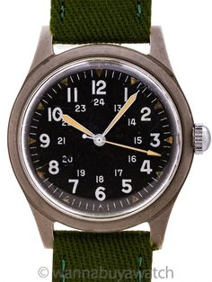 US Military Issue Benrus Post Vietnam Era circa 1974 - US Military issue Benrus man's wristwatch post Vitenam era featuring 34 X 41mm non reflective brushed finish base metal case, acrylic crystal, and original matte black dial with 24 hour indexes and triangular luminous hour indexes, luminous hands and arrow tipped sweep seconds hand. Powered by 17 jewel manual wind movement recently serviced and guaranteed. Military caseback marks read #GS-06S-7744 June 1974. Offered with a NATO style or… Military Issue, Modern Watches, Bracelet Sizes, Matte Black, Rolex Watches, Vietnam, Jewels, Crystals, Metal